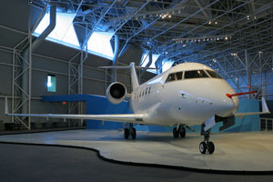 business jet in airport hangar